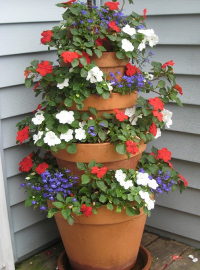 The Terra Cotta Pot Flower Tower Is Made By Using Terra Cotta Pots In  Descending Sizes, Stacked On Top Of One Another. The Tower Of Pots  (anchored Together ...