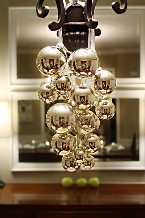 ball ornaments hanging from chandelier