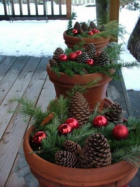 Greenery and ornaments in planters for Christmas