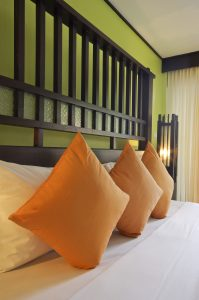 greenery paint with orange pillows