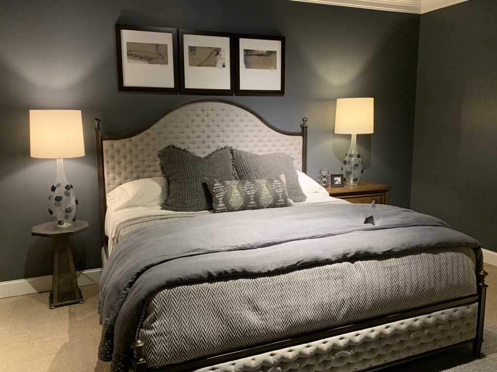 Grey bedroom layout with white headboard