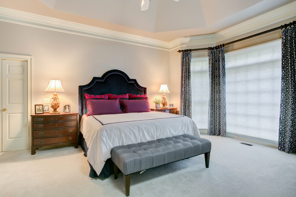 bedroom with clean decor navy blue headboard